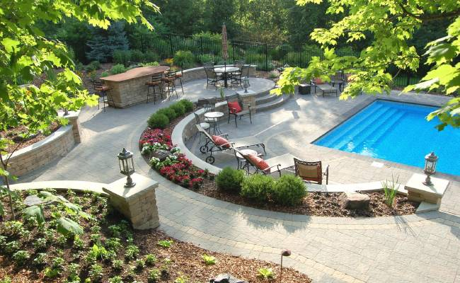 Hardscaping and landscaping around a pool