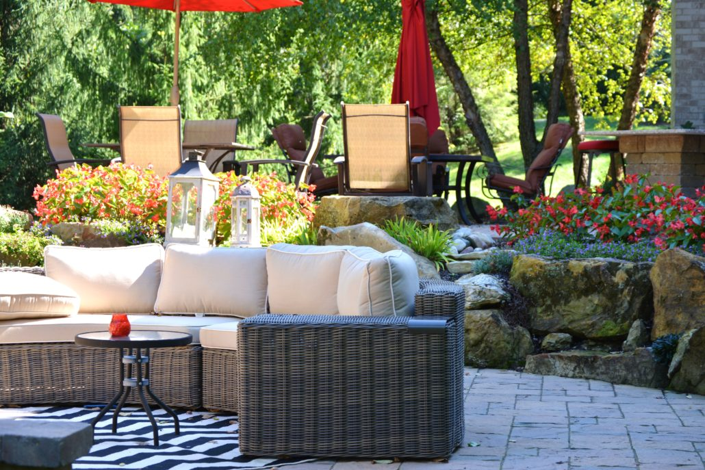 Plant Studio Landscaping back patio with hardscape and patio furniture