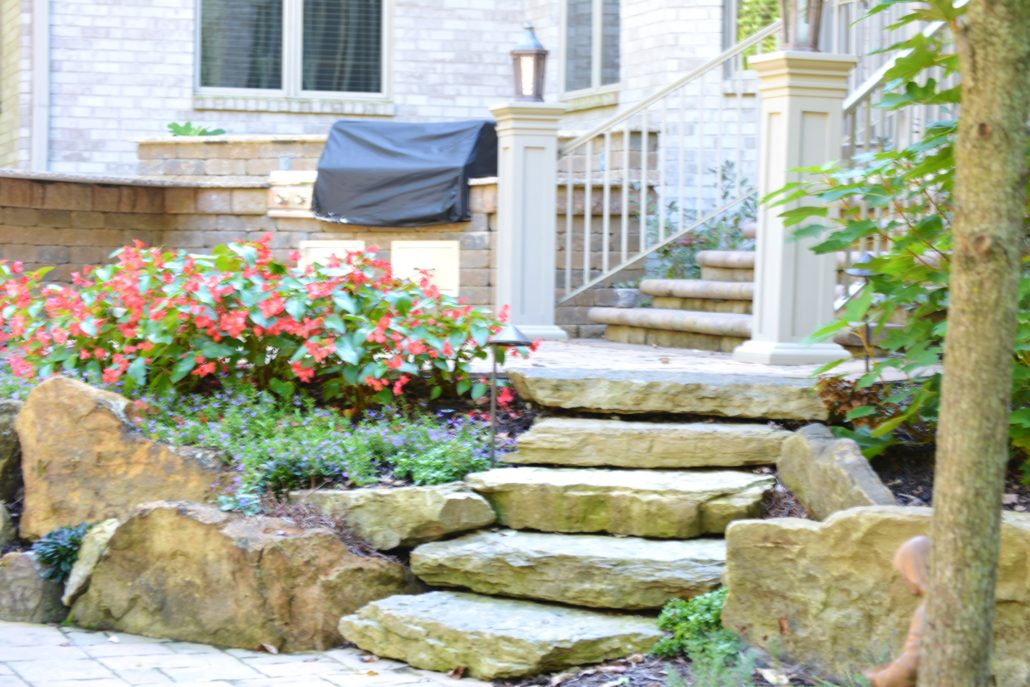 Hardscape steps surrounded by annual flowers
