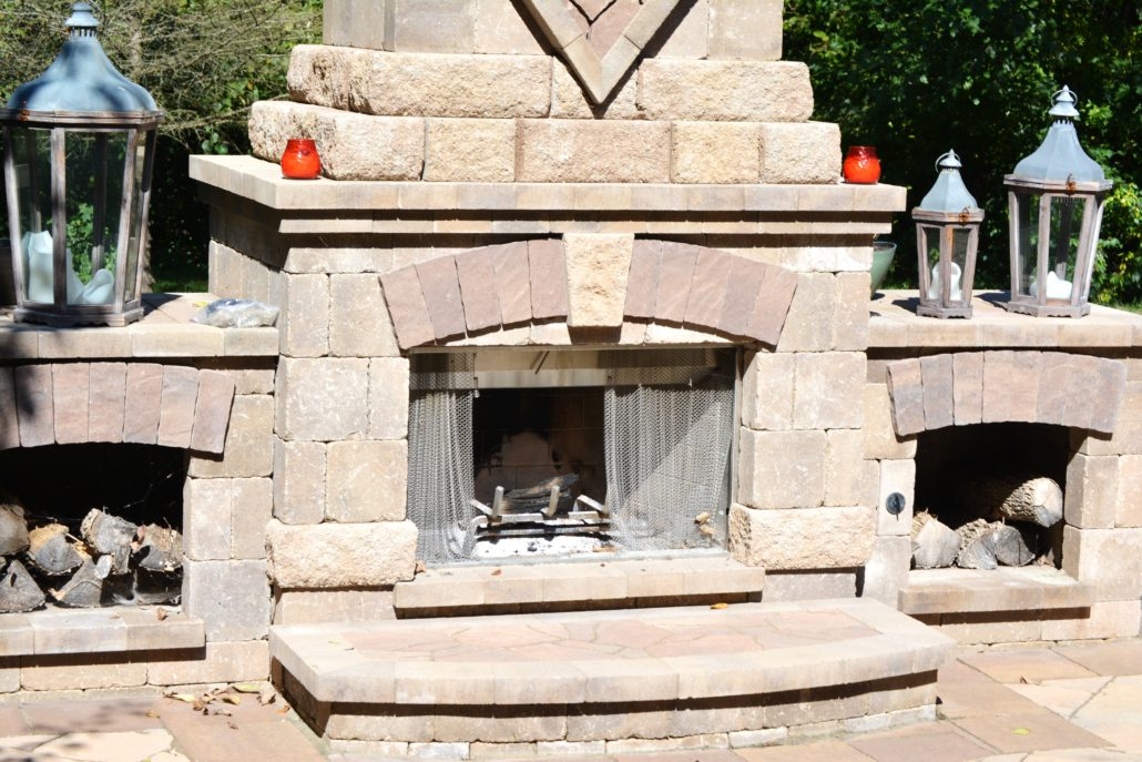 Bricked outdoor fireplace and lighting ornaments