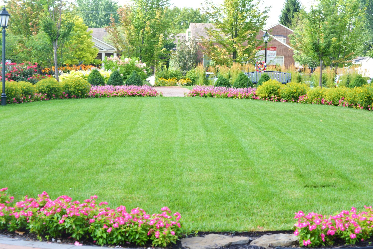 Mowed lawn inside of large circular flowerbed