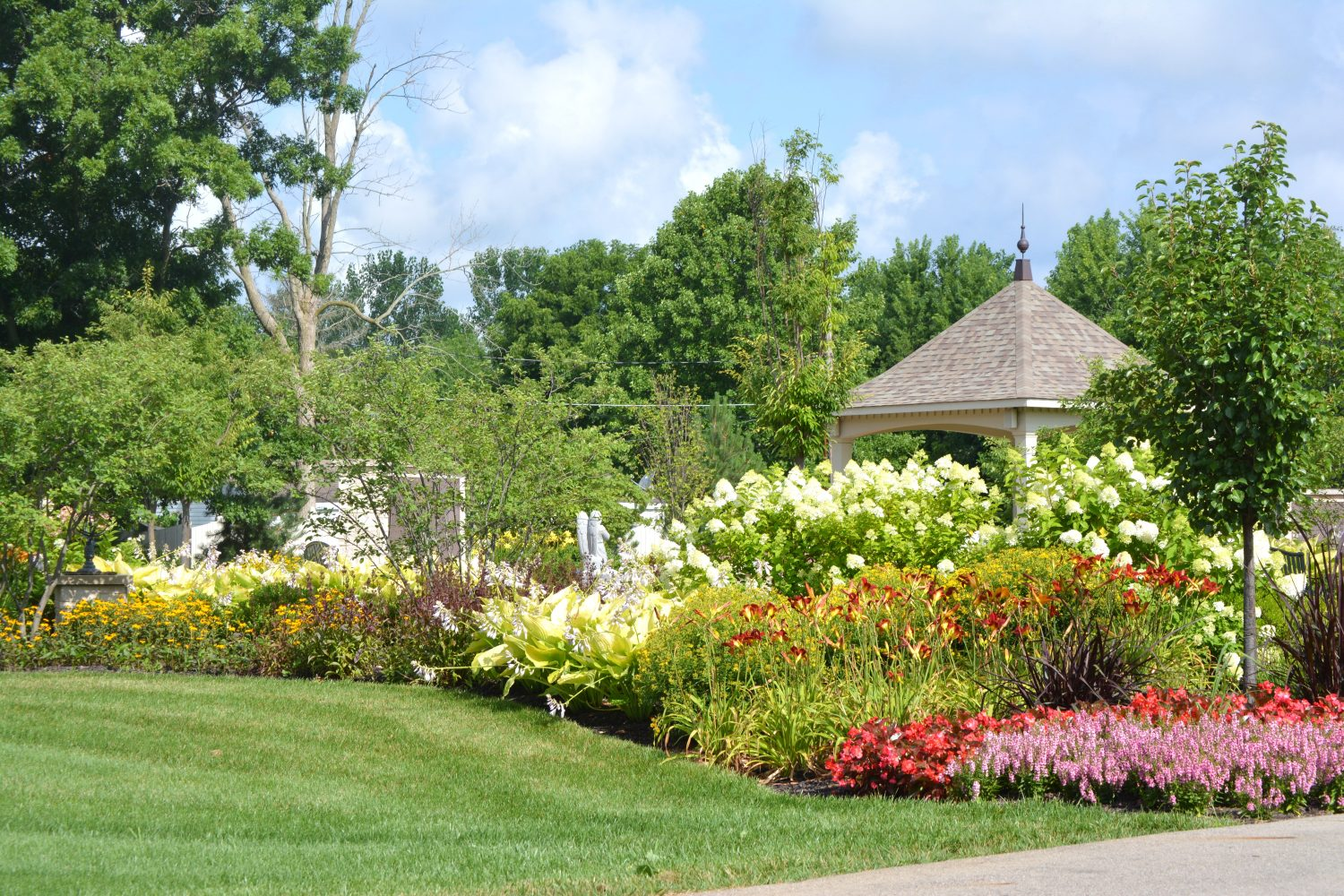 Full Flower bed, with pergola sitting in background